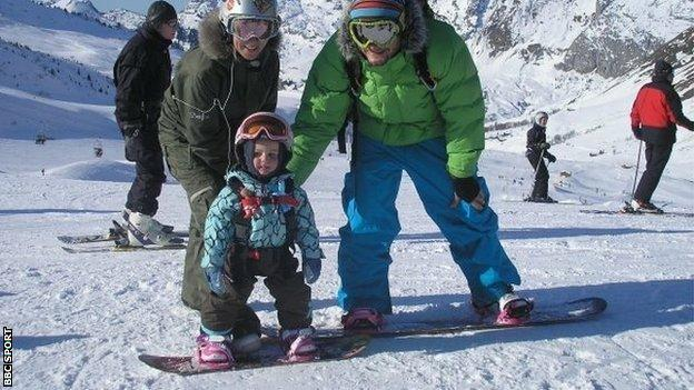 Mia Brookes aged 22 months old on a snowboard