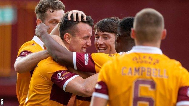 Motherwell players congratulate David Turnbull