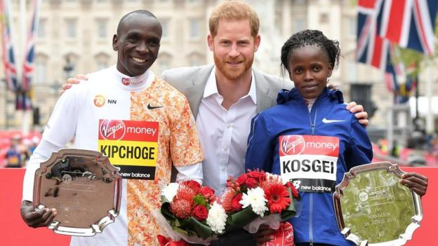 Eliud Kipchoge and Brigid Kosgei with Prince Harry