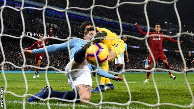 John Stones clears the ball off the line against Liverpool