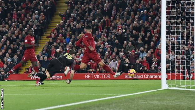 Roberto Firmino scoring a no-look goal against Arsenal