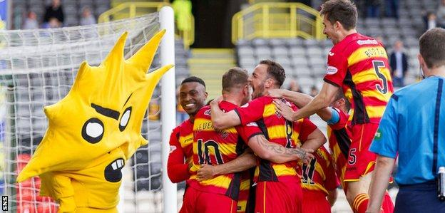 Partick Thistle mascot Kingsley celebrates with the players at Firhill