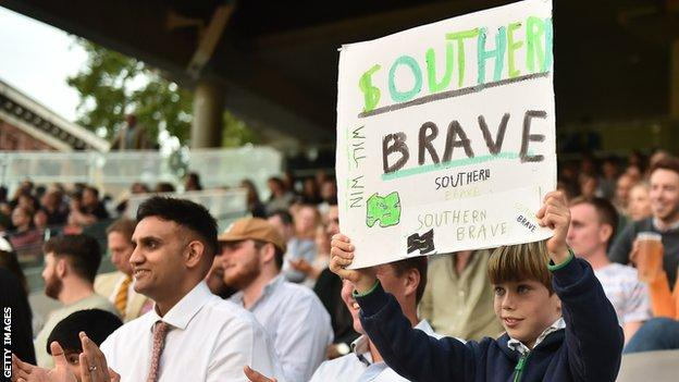 A Southern Brave fan holds up a sign at Lord's for the Hundred final