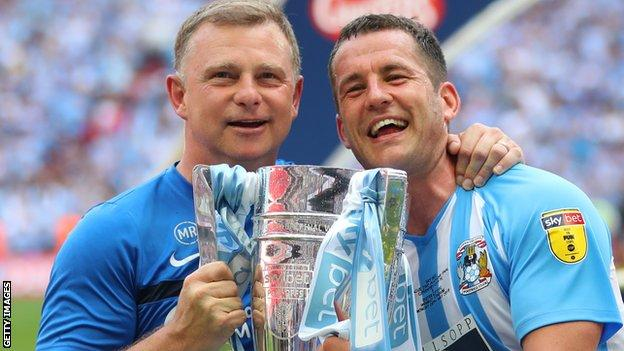 Coventry City manager Mark Robins with captain Michael Doyle