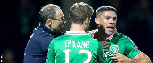 Martin O'Neill attempts to calm Jonathan Walters after some vigorous Moldovan challenges