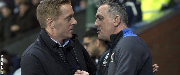 Garry Monk and Owen Coyle shake hands