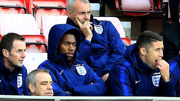 Daniel Sturridge looks on as he missed England's game against Australia with a calf injury