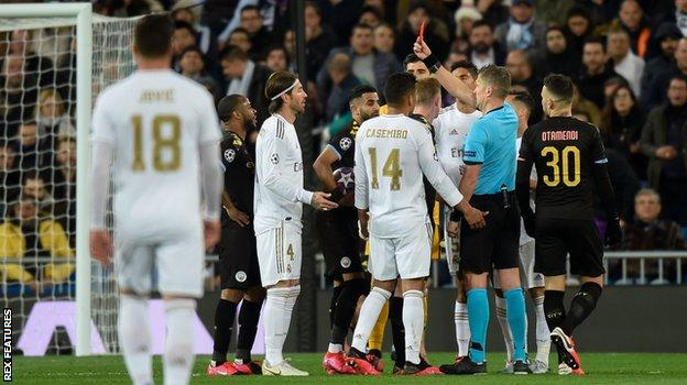 Sergio Ramos is shown a red card for his foul on Gabriel Jesus