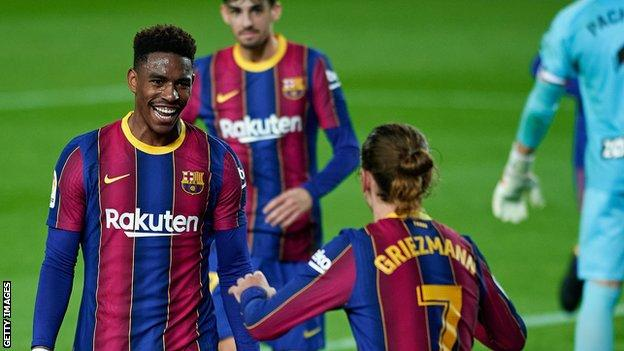Junior Firpo celebrates a Barcelona goal