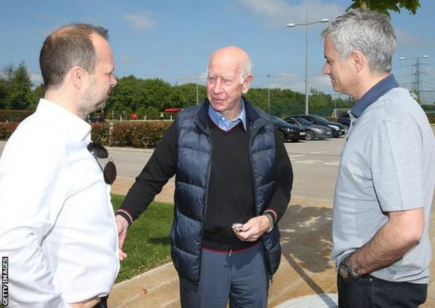 Jose Mourinho is pictured with Manchester United legend Sir Bobby Charlton (centre) at the club's training ground along with executive vice-chairman Ed Woodward