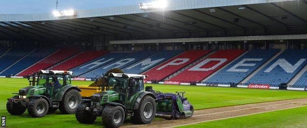 Work begins to relay the pitch at Hampden