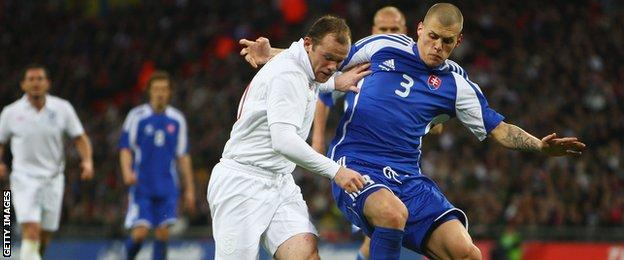 Wayne Rooney (left) and Martin Skrtel faced each other when England and Slovakia met in a 2009 friendly