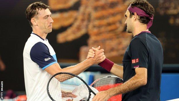 John Millman (left) and Roger Federer
