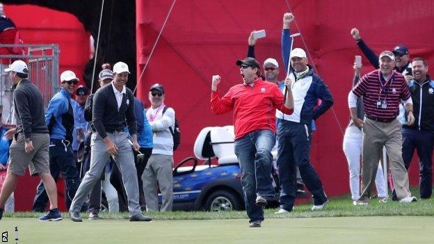American fan celebrates making putt