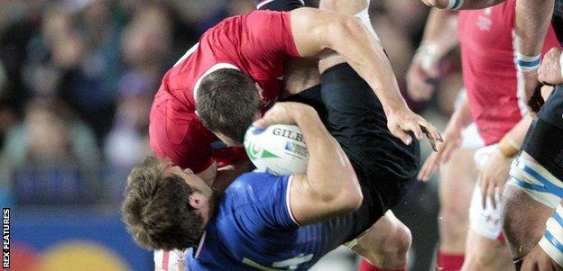 Wales skipper Sam Warburton up-ends France wing Vincent Clerc