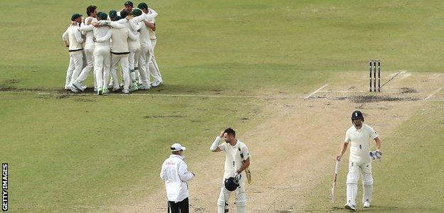 James Anderson walks off after Australia win the Ashes