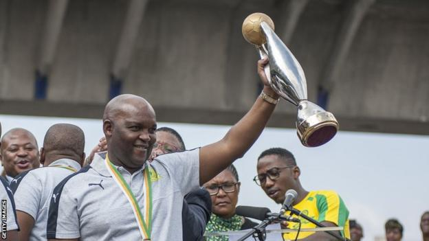 South African coach Pitso Mosimane celebrates with the African Champions League trophy after winning with Mamelodi Sundowns