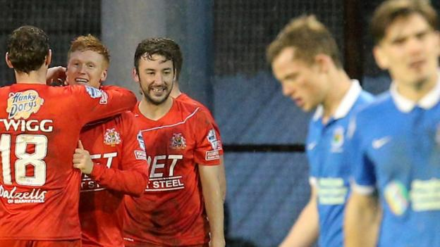 Portadown's Chris Casement is congratulated after scoring the opening goal in the 2-0 win over Linfield