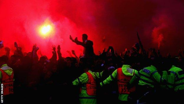Liverpool fans light flares before the Champions League semi-final with Roma at Anfield