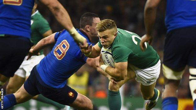 Ian Madigan takes on the France defence in Cardiff