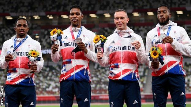 Team GB's 4x100m team at Tokyo 2020: Zharnel Hughes (centre-left), Richard Kilty (centre-right) and Nethaneel Mitchell-Blake (right)