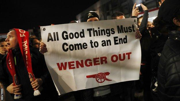 Fans protesting against Arsene Wenger