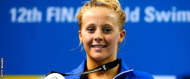 Siobhan-Marie O'Connor of Great Britain poses with her silver medal after finishing second in the Women's 100m Individual Medley Final on day three of the 12th FINA World Swimming Championships