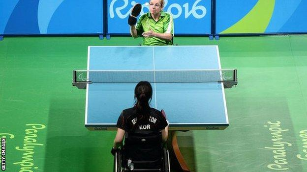 Rena McCarron Rooney of Ireland serves during the quarter-finals against Su-Yeon Seo of South Korea in table tennis at the Rio Paralympic Games