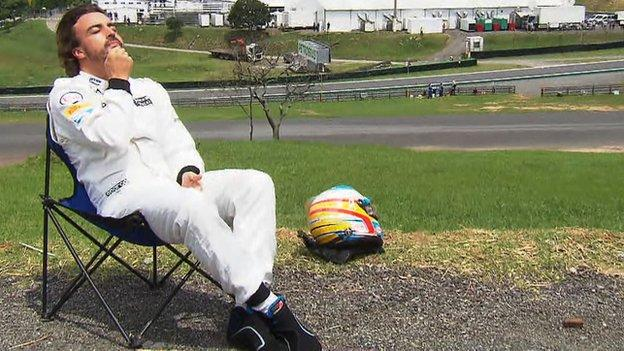 Fernando Alonso sunbathing at Interlagos