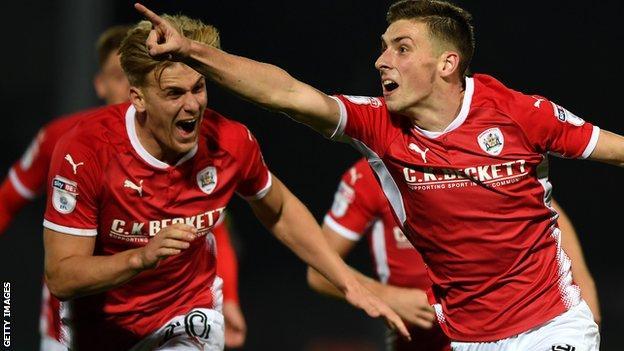 Joe Williams celebrates Barnsley's third goal against Burton
