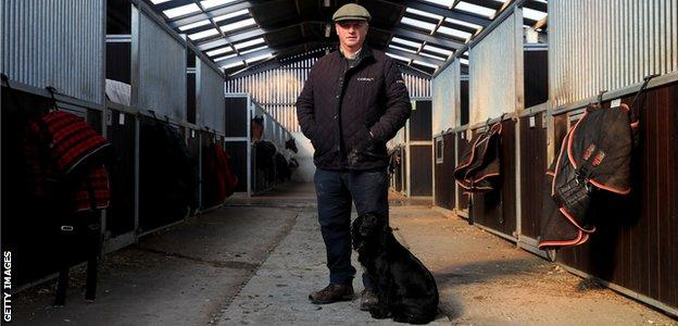 Colin Tizzard on the family farm with his dog Snipe