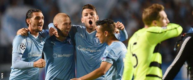 Malmo celebrate as Celtic midfielder Kris Commons trudges off