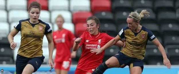 Liverpool's Katie Zelem (centre) competes for possession with Arsenal's Jordan Nobbs (right)