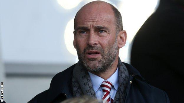 Sunderland chief executive Martin Bain looks on