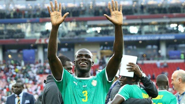 Kalidou Koulibaly celebrates the 2018 World Cup win over Poland