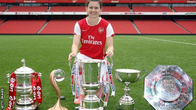 Karen Carney with quadruple trophies