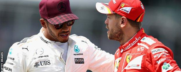 Lewis Hamilton and Sebastian Vettel have a chat after qualifying