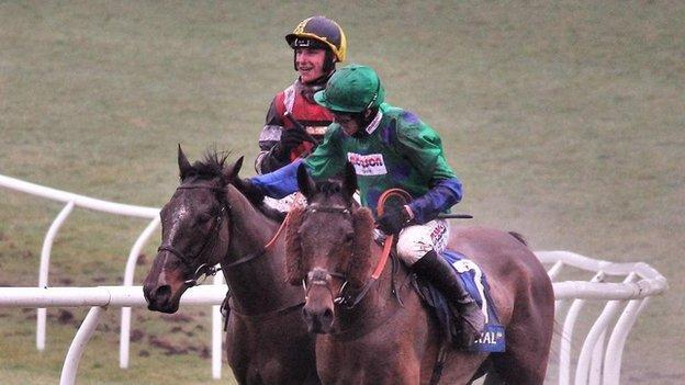 Lorcan Williams pats Jack Tudor's winner Potters Corner in the Welsh Grand National in December