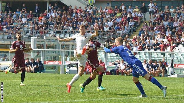 Joen Hart (right) in action for Torino against Roma
