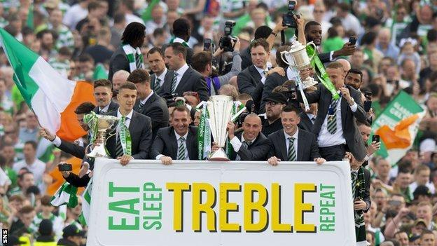 Brendan Rodgers and his squad celebrate winning the 'Double-treble'