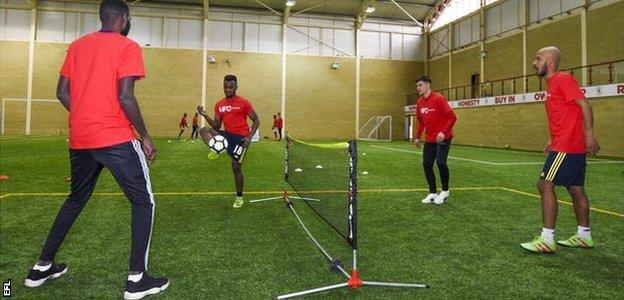 Middlesbrough midfielder Muhamed Besic, second from right, trains with refugee footballers who play for Club Together