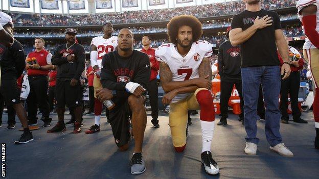Colin Kaepernick kneels for the national anthem