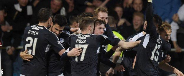 Dundee players celebrate