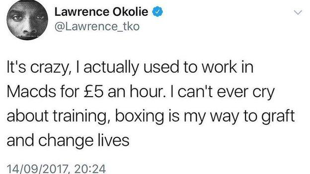 """Okolie tweet reads: """"It's crazy, I actually used to work in Macds for £5 an hour. I can't ever cry about training, boxing is my way to graft and change lives."""""""