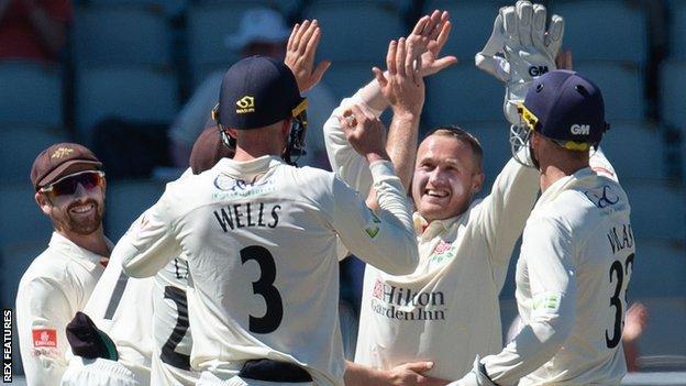 Matt Parkinson celebrates a wicket for Lancashire