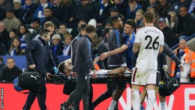 Brady is stretchered off against Leicester City