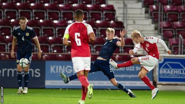 Denmark's Gustav Isaksen scores the opening goal during the UEFA Under-21 Championship Qualifier match between Scotland and Denmark
