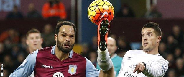 Everton's Kevin Mirallas (right) in action with Aston Villa's Joleon Lescott