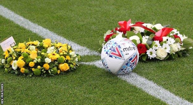 Floral tributes to Justin Edinburgh at the pre-season friendly between Leyton Orient and Norwich