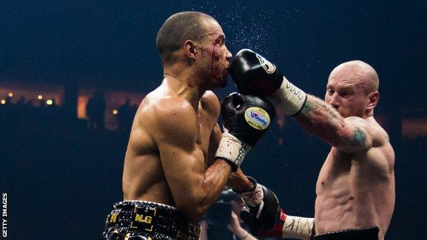 George Groves (right) lands a punch on Chris Eubank Jr